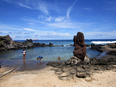 We had wonderful weather for our first full day. Down at the nearest beach, after I'd avoided drowning, we walked around and saw several Moai and this lovely little swimming area where children would not be swept to sea.