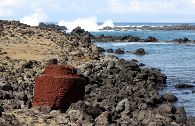 "Aside from the reconstructed Moai guy shown in a photo up top, this red chunk of rock was the first of a lot of ""topknots"" (representing a hairstyle) that we saw knocked off around the island."