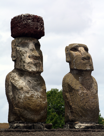 Closeup  of the two Moai on the very right,  to show an example of one wearing the hat.  There is also a batch of inland Moai.  We bought some lovely fresh pineapple from a lady nearby.